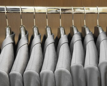 Row of men suit jackets in apparel store